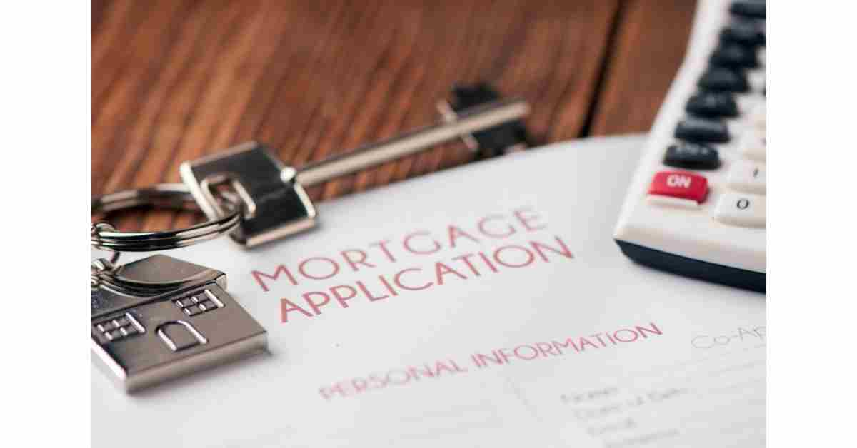 Mortgage Application form and keys to a house.  Mortgages costs are set to rise for some