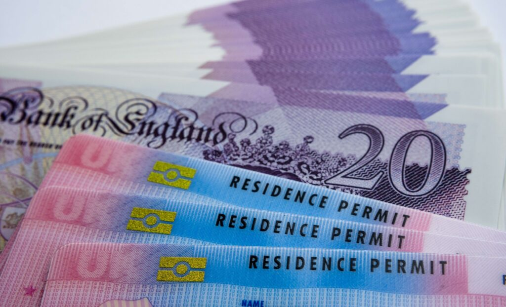 £20 note and residence permit. BNO holders can apply for a visa with a route to citizenship.