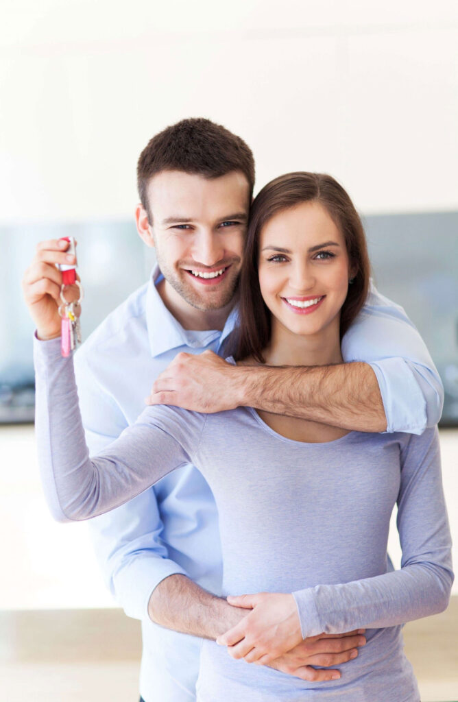 A young couple - most couples buy their homes as Joint Tenants